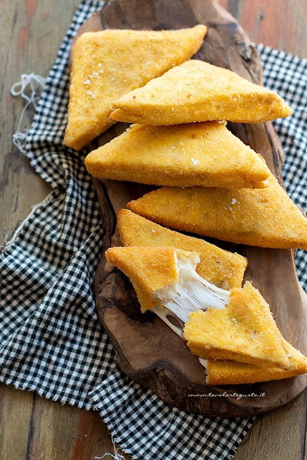 Mozzarella in carrozza al forno - Ricetta Mozzarella in carrozza al forno-