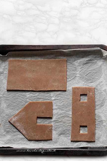 cuocere in forno i pezzi della casetta pan di zenzero